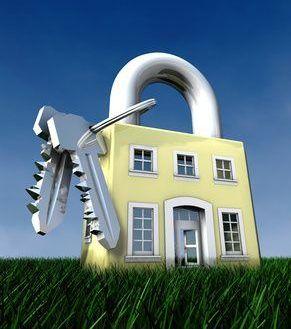 Haus als Vorhängeschloss